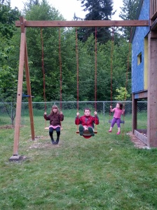 Happy swinging kids. (and my silly son who cant resist making faces at the camera)