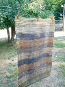 3 Kevin's Quality Clothespins hanging a wet heavy rug