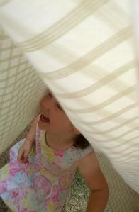 Peekaboo in the sheet